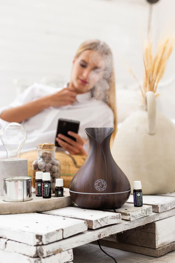 Use Scentimeter® Aromatherapy's latest ebony tulip-shaped wood-looking SMART ultrasonic essential oil aroma diffuser to relax after a difficult day.